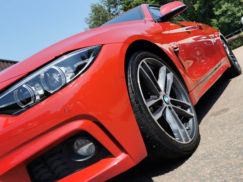 new car protection red bmw